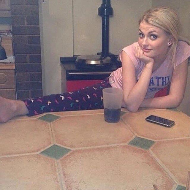 Lucy Fallon in casuals with a drink