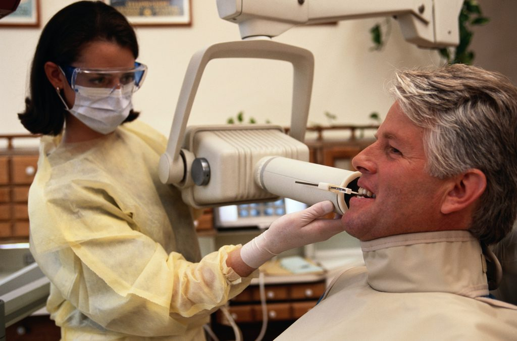 Dentist taking xray of teeth